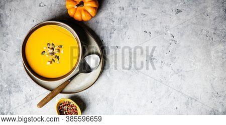 Vegetarian autumn pumpkin cream soup with seeds