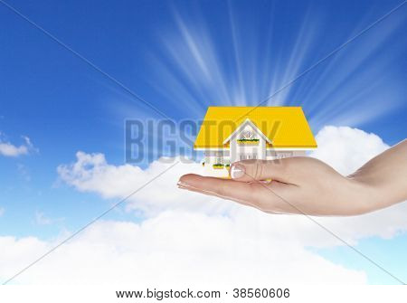 Hand holding / offer house. Real estate concept. Handful collection.