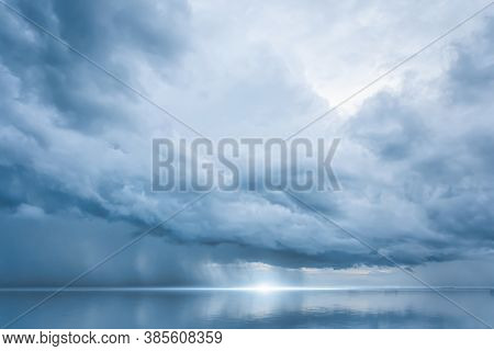 Dramatic Blue Sky At The Sea With Clouds Reflection In Water, Dark Color, Ocean Storm