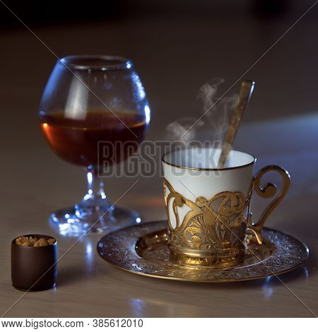 Wineglass Of Brandy, A Golden Coffee Cup, A Spoon, Chocolate On The Table, Luxurious Elegance Style