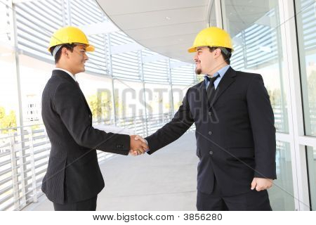 Men Architects Shaking Hands