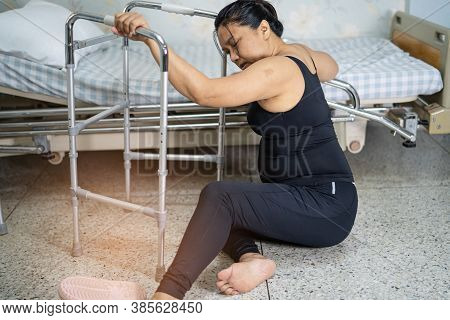 Asian Middle-aged Lady Woman Patient Falling In Living Room Because Slippery Surfaces