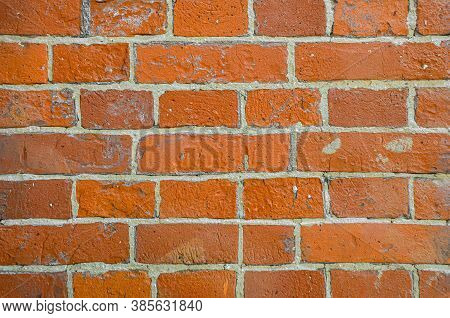 Close-up Coarse Texture With Bright Orange, Uneven Exposed Brick. Texture Background Material Constr