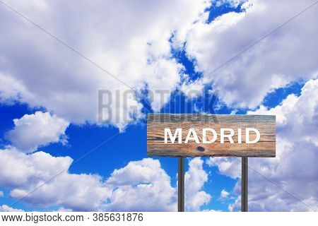 Sign With Inscription Madrid With View Of Sky. Pointer Of The Settlement. Road Sign Indicating Settl