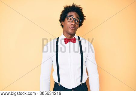 Handsome african american man with afro hair wearing hipster elegant look smiling looking to the side and staring away thinking.