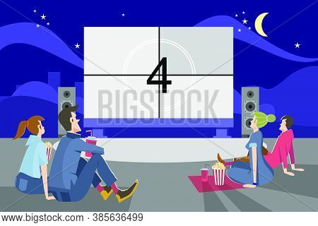People Watching Movie Outdoors In Evening. Couples Dating In Open Air Cinema Theater And Sitting At