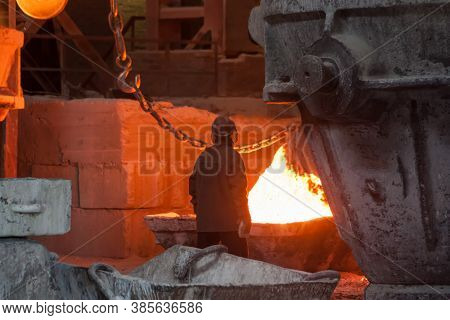 Smelting Metal Liquid Iron Foundry. Industrial Metallurgical Plant
