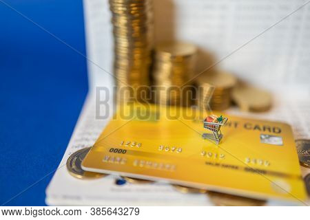 Business, E-commerce And Money Concept. Closeup Of Miniature Shopping Cart Or Trolley On Mockup Fake