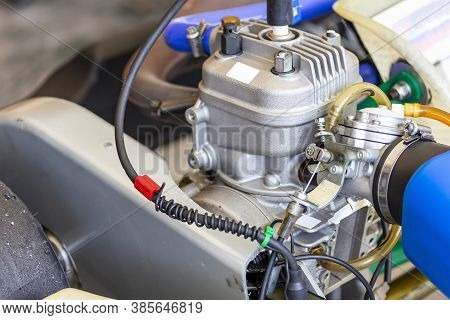 Close Up Carburetor And Cable Choke Assembly With Body And Cylinder Head Of 4 Stroke Engine Of Sport