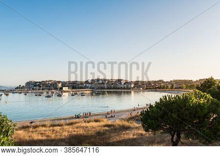 Portonovo, Spain - August 7, 2020: Wide-angle View Of The Beach And Sport Port Of Portonovo In The R