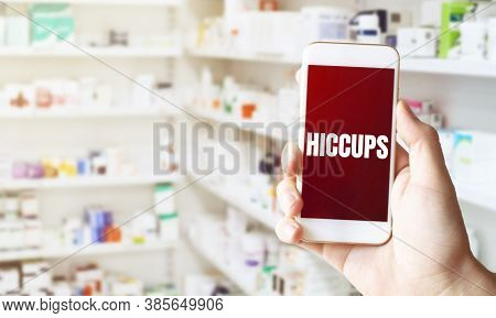 Hand Holding Smart Phone In Pharmacy Drugstore. Text Hiccups