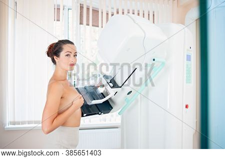 Healthy Young Woman Doing Cancer Prophylactic Mammography Scan At Hospital.