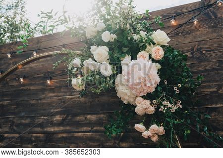 Beautiful Wooden Arch For A Wedding Ceremony. Wedding Ceremony In The Fresh Air. The Arch Is Decorat