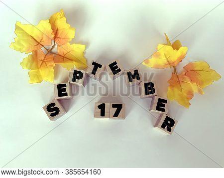 September 17 On Wooden Cubes On A White Background .calendar For September.autumn