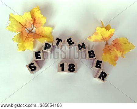 September 18 On Wooden Cubes On A White Background .calendar For September.autumn