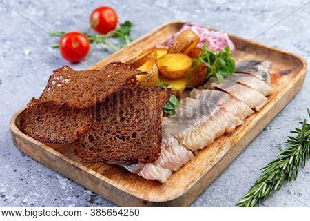 Chopped Salted Herring Fillet, Baked Potato Wedges And Thinly Sliced Rye Bread