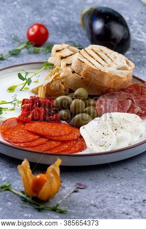 Various Antipasti Appetizers. Cheese, Salami, Olives, Mix And Sun-dried Tomatoes.