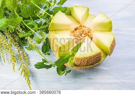 Sliced Melons With Mint   . Sweet Melon Half On The Wood