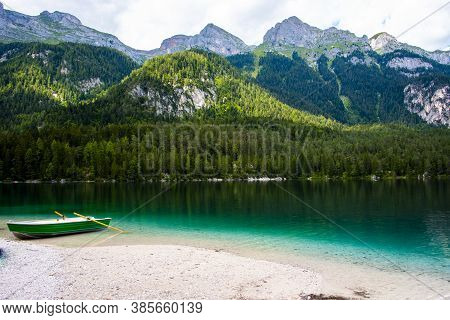 The Peaks Of The Dolomites In The Adamello Natural Park Are Reflected And Tinged With Green The Alpi