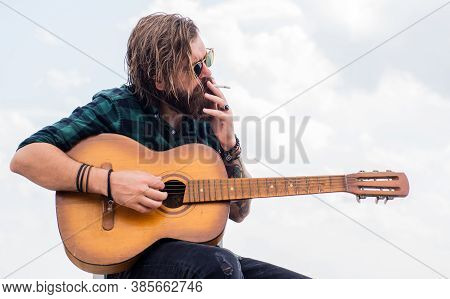 Acoustic Guitar Player. Mature Hipster Musician With Beard. Brutal Caucasian Guy Playing Guitar. Cou