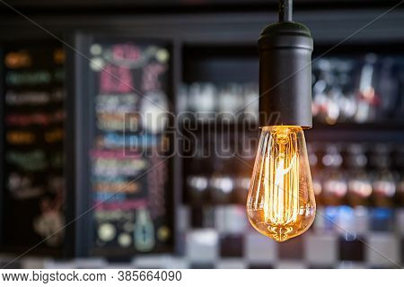 Close Up Selective Focus View Of Luminous Vintage Edison Bulb, Electric Incandescent Light Lamp. Res