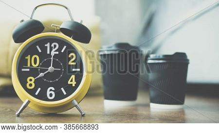 Retro Clock With An Alarm Clock In The Apartment,in The Background Cappuccino Aromatic Black Coffee,