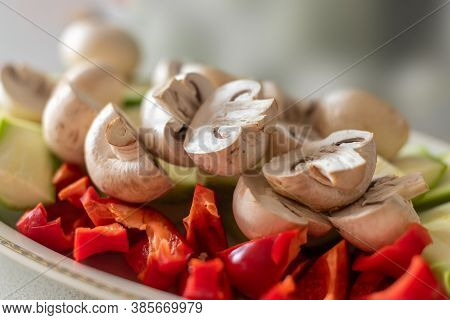 Mix Of Fresh Various Vegetables And Champignons Prepared For Coocking On Grille. Sliced And Chopped
