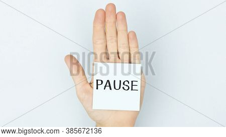 The Word Pause Is Written On A Piece Of Paper That The Quarantined Girl Is Holding