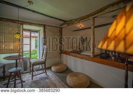 Jeju City,south Korea-july 2019: Bohemian Vintage Style Cafe Interior With Rattan And Wooden Furnitu