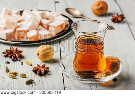Tea In Arab Glass With Turkish Delight Rahat Lokum And Different Over Wooden Surface