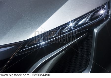 Predatory Car Headlight Of Powerful Sports Vehicle With Grey Bodywork, Automobile Industry
