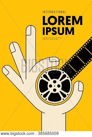 Movie And Film Poster Design Template Background With Human Hand Holding Film Reel. Can Be Used For