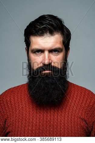 Portrait Of Confident Serious Man Has Beard And Mustache, Looks Seriously, Isolated. Hipster Thinkin