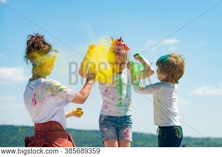 Bright Summer Colors. Group Of Children Enjoying Playing With Colored Powder And Color Dust Splash