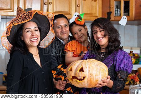 A Family In Disguise Of Halloween Smiling