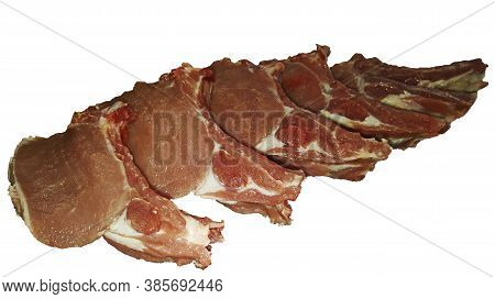 Photo Of Isolated Pork Tenderloin On A Rib Cut Into Pieces On A Board On A White Background