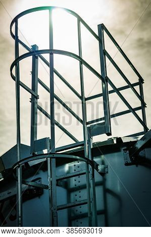 Ladder On Agricultural Silo, Storage Tank Cultivated Agricultural Crops Processing Plant. Tower Exte