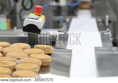 Cupcake Packing Machine ; Food Industrial Business Backgound ; Selective Focus