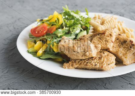 Cooked Turkey Breast, Vegetable Salad With Cherry Tomatoes, Yellow Bell Pepper, Cucumber And Arugula