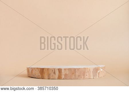 Round Wooden Saw Cut Cylinder Shape On Beige Background Abstract Background. Minimal Box And Geometr