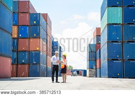 Manager And Contenner Worker Working In The Construction Container Yard,industrial Container Yard Fo