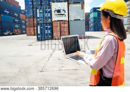 Contenner Woman Worker With Laptop Checking Position Loading Containers Box,large Container Shipping