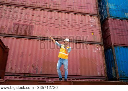 Container Worker Loading Containers Box For Import Export At Industrial Container Cargo.