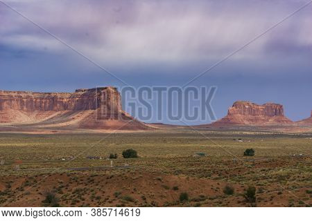 Monument Valley Famous Arid Red-sand Landscape With Outstanding Geological Rock Buttes And Mesas In