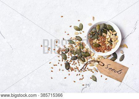 White Bowl With Different Seeds As Snack, Ingredient For Oil, Mix For Healthy Salad