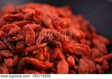 Close-up Of Dry Goji Berries In Black Bowl