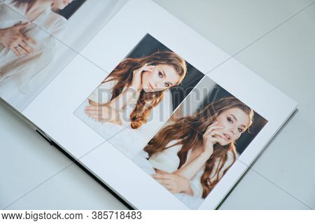 Open Wedding Photo Book. Flipping Through A Photobook With Thick Pages On A White Table. Convenient,