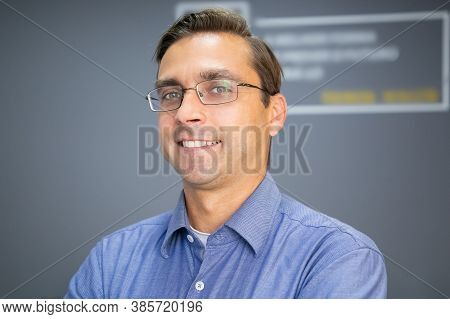 Closeup Portrait Of Caucasian Happy Teacher In Glasses. Middle-aged Handsome Man In Eyeglasses Posin