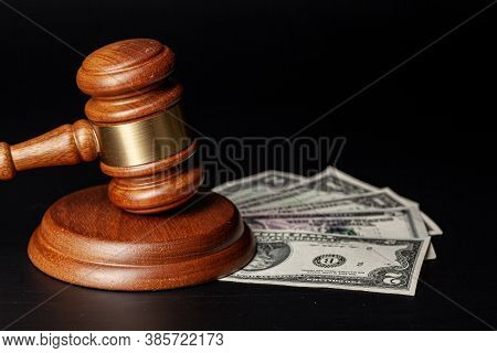 Law Mallet And A Stack Of Money
