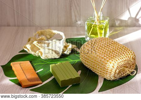 Natural Ecological Washcloth, Wooden Brush For Dry Massage, Olive Soap And Wooden Comb On A Wooden L